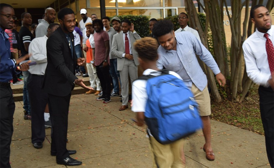 Wiley College students greet children on the first day of school